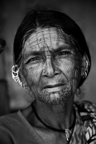 Tribal Woman with Tiger tattoo face